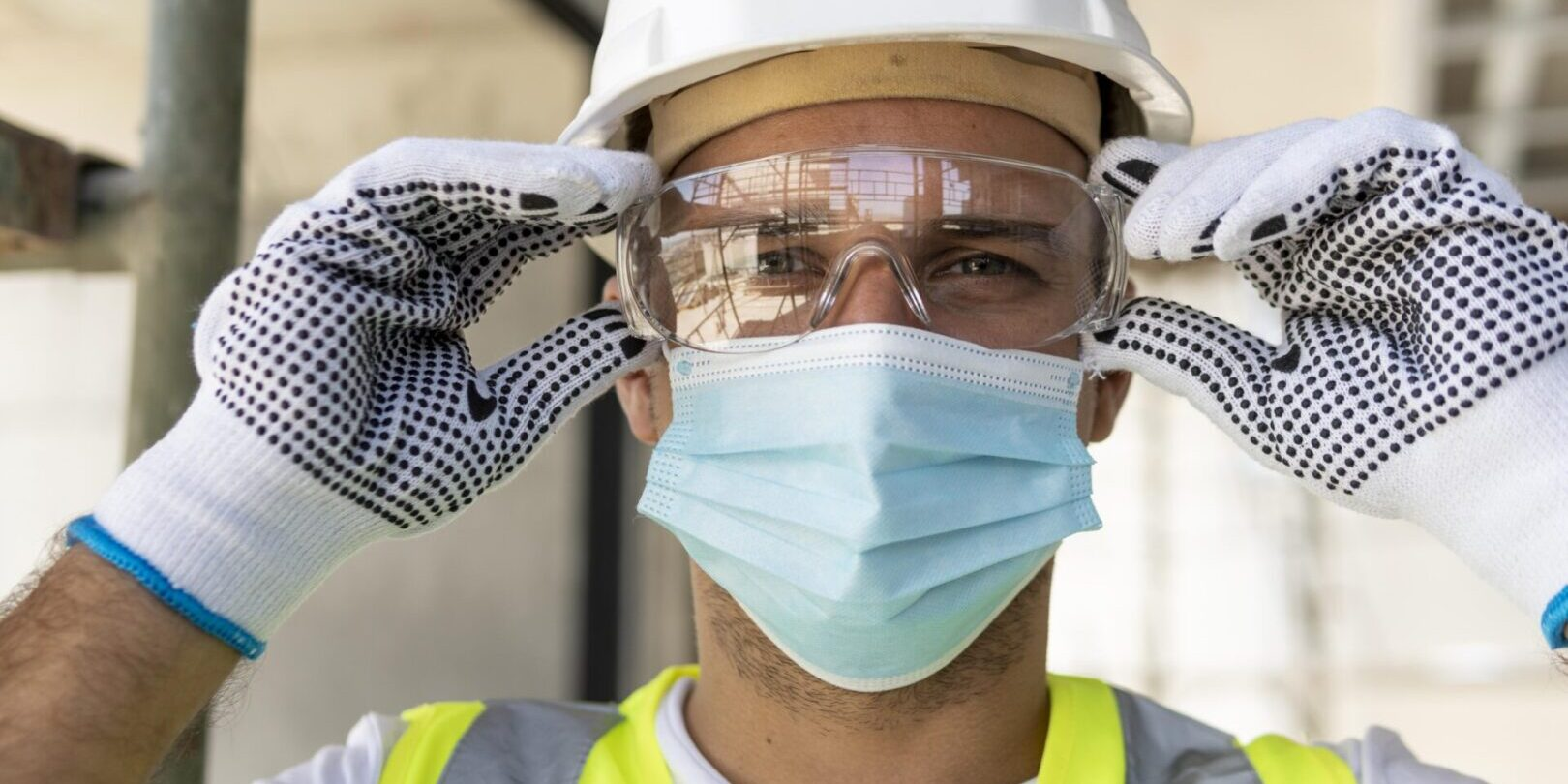 worker-wearing-safety-glasses-on-construction-site